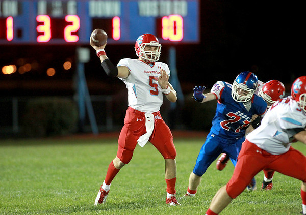 Marian Central quarterback Chris Streveler passes the ball during their game at Marmion Academy in Aurora Friday night.