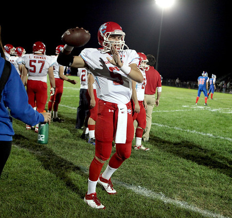 Marian Central quarterback Chris Streveler (5) Warms up with his team before Friday night's game at Marmion Academy.