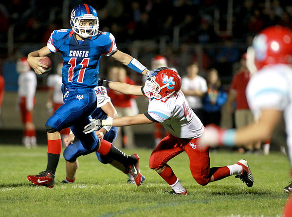 Marmion quarterback Brock Krueger keeps the ball during their home game against Marian Central Friday night.