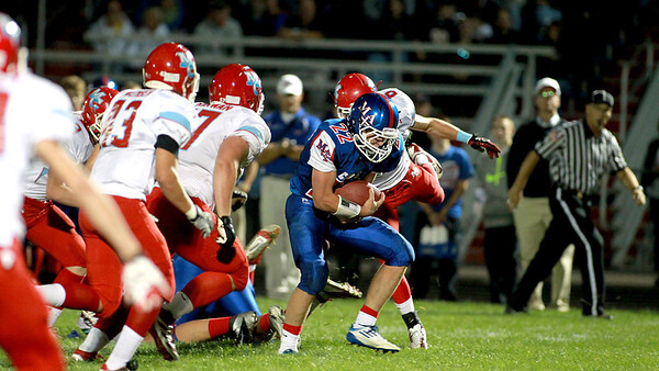 Marian Central vs. Marmion Academy in Aurora Friday night.
