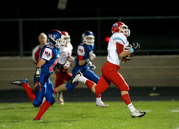 Marian Central's Greg Walczak catches a pass for a touchdown during their game at Marmion Academy in Aurora Friday night.