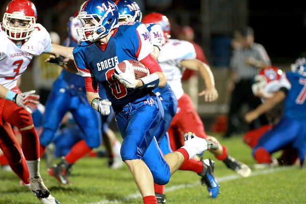 Marmion's Jake Ruddy runs with the ball during their home game against Marian Central Friday night.