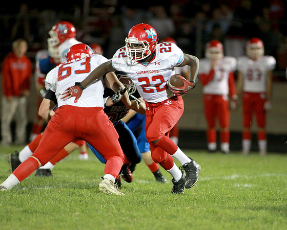 Marian Central's Ephraim Lee runs with the ball during their game at Marmion Academy in Aurora Friday night.