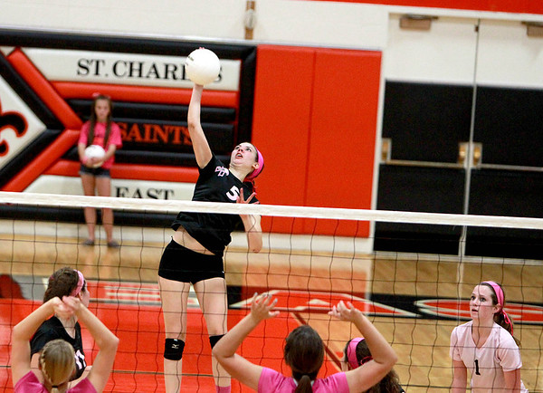 Nicole Woods of St. Charles East spikes the ball during East's 25-21, 25-12 win over St. Charles North Tuesday night.