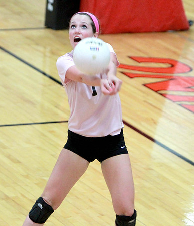 St. Charles East's Anne Hughes bumps the ball during their 25-21, 25-12 win over St. Charles North Tuesday night.
