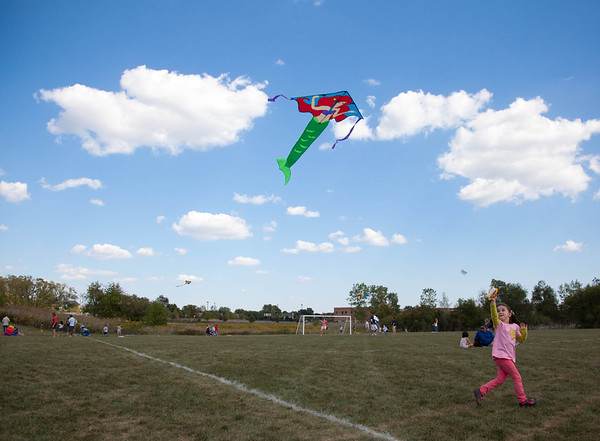 Four-year-old Alessandra Centimano, age 4, flies her mermaid kite during Genevas Park District's annual kite festival Saturday at Peck Farm.