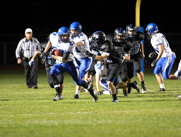 Geneva's Joseph Boenzi runs with the ball during their game at St. Charles North Friday night.
