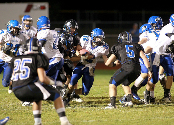 Geneva's Bobby Hess runs up the middle during their game at St. Charles North Friday night.