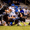 St. Charles North's George Edlnd is taken down by Geneva's Cody Murphy (52) during their game at North Friday night.
