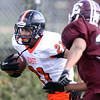 Jeff Krage – For the Kane County Chronicle<br /> St. Charles East's Erik Anderson carries the football during Saturday's game at Elgin.<br /> Elgin 9/22/12