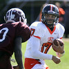 Jeff Krage – For the Kane County Chronicle<br /> St. Charles East quarterback Jimmy Mitchell keeps the football during Saturday's game at Elgin.<br /> Elgin 9/22/12