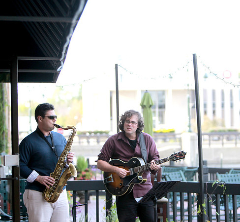 Jazz saxophonist Chris Madsen (left) and jazz guitarist Tim Fitzgerald play on the patio of Bistro One West Thursday evening as part of the St. Charles Jazz Weekend sponsored by the St. Charles Downtown Partnership.