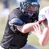 St. Charles North defensive lineman Matt Pretet fights off teammate Camden Cotter during practice Wednesday afternoon.