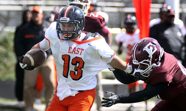 Jeff Krage – For the Kane County Chronicle<br /> St. Charles East's Anthony Sciarrino returns a punt for a touchdown in the first quarter of Saturday's game at Elgin.<br /> Elgin 9/22/12