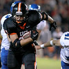 St. Charles East's Erik Anderson runs with the ball during their homecoming game against Geneva Friday night.