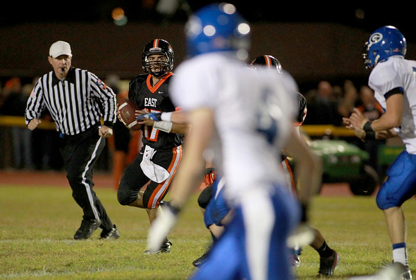 St. Charles East quarterback Jimmy Mitchell looks to make a pass during their homecoming game against Geneva Friday night.