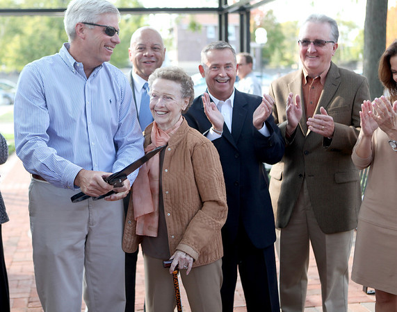 Doris Hunt (center), founder of CASA Kane County, is applauded after cutting the ribbon for the Court Appointed Special Advocate Grow a Healthy Child Garden outside the Kane County Courthouse in Geneva Friday afternoon.
