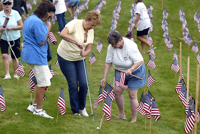 H. Rick Bamman -hbamman@shawmedia.com Sun City of Huntley residents plant flags Friday for the 911 observance. Bob Wold( yellow) and Chuck Czochara (white) Marilyn Laya (Iowa), Catherine Porterra (yellow) Peg Mulhall (hat) Ret, Marine Chuck Moran (blue shirt) Gloria Entzminger (white) Emmetta Shepard (red) husband John. Ileen Prus plaid and Kathy Zakos (blue)