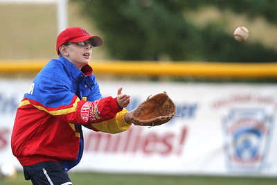 Mike Greene - mgreene@shawmedia.com Geoffrey Boston, 12 of South Elgin, watches a ball into his glove as rain falls during the first annual Challenger Jamboree hosted by the Tri Cities Little League Friday, September 7, 2012 at Randall Oaks Park in West Dundee. Friday's events featured skills practices, a hayride, and a bonfire with organized games and other activities set for Saturday.