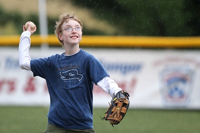 Mike Greene - mgreene@shawmedia.com Matthew Williams, 11 of Schaumburg, winds to throw while playing catch as rain falls during the first annual Challenger Jamboree hosted by the Tri Cities Little League Friday, September 7, 2012 at Randall Oaks Park in West Dundee. Friday's events featured skills practices, a hayride, and a bonfire with organized games and other activities set for Saturday.