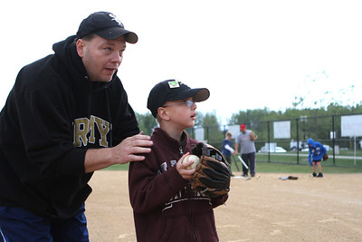 Mike Greene - mgreene@shawmedia.com Bob Kennedy, of Bartlett, helps his son Matthew, 8, practice pitching during the first annual Challenger Jamboree hosted by the Tri Cities Little League Friday, September 7, 2012 at Randall Oaks Park in West Dundee. 100 challenger individuals from 10 teams will participate in the two-day event with games and other events on Saturday.