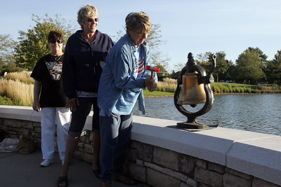 H. Rick Bamman - hbamman@shawmedia.com Sun City residents Dianne Deegan and Linda Bahwell toll the bell at 7:46 Tuesday morning for the crash of American Airlines Flight 11 into the World Trade Center eleven years ago. Mary Ann Zachary blue denim United Flight 175 Bob and Diane Peterson (white sweats) American Airlines FLight 77 into the Pentagon.