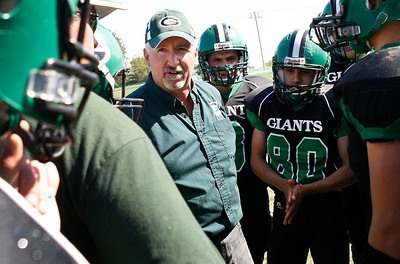 Candace H. Johnson/For the Northwest Herald Alden-Hebron's head coach John Lalor talks with Adam Burmeister, assistant coach, and the varsity football players during a time-out in the second quarter against CICS-Longwood at Alden-Hebron High School.
