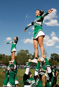 Candace H. Johnson/For the Northwest Herald Alden-Hebron cheerleaders support their varsity football team as they play against CICS-Longwood in the fourth quarter at Alden-Hebron High School.
