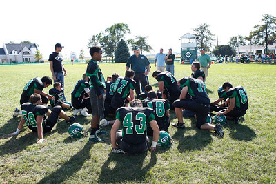 Candace H. Johnson/For the Northwest Herald Alden-Hebron's head coach John Lalor talks with his football players on the field after they beat CICS-Longwood 45-8 at Alden-Hebron High School.