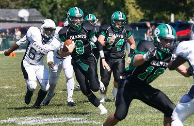 Candace H. Johnson/For the Northwest Herald Alden-Hebron quarterback, Bryce Lalor, runs the ball against CICS-Longwood in the first quarter at Alden-Hebron High School.