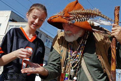 Brett Moist/ for the Northwest Herald  Johnny Appleseed (played by Steve McPhail) give 11 year old Danielle Lattancio a few priceless gems during the annual Johnny Appleseed Festival in downtown Crystal Lake on Saturday.