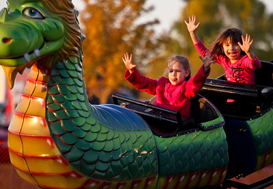 Josh Peckler - Jpeckler@shawmedia.com Tiffany Cuccinello, 6 (left) of Lake in the Hills and Ava Gee, 5 of Oak Park puts their hand in the air as they ride the Dragon Wagon at the Huntley Fall Fest held at Deicke Park in Huntley, Saturday, September 29, 2012.