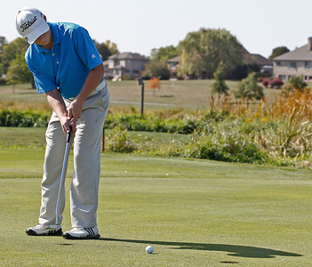 Brett Moist/ for the Northwest Herald  Jacob's Jack Rimsett sinks his putt during the Crystal Lake South Golf Tournament at the Red Tail Golf Course in Lakewood on Saturday
