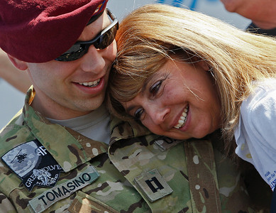 Brett Moist/ For the Northwest Herald  U.S Army Captain Kyle Tomasino hugs his mother, Kathy, after returning home from his tour in Afghanistan. Kyle was escorted via the Warriors watch to a special welcome home party at the Golf Club of Illinois on Saturday in Algonquin.
