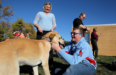 "Mike Greene - mgreene@shawmedia.com Cinsy Cimaglio watches as her son Zach pets their dog Lucy during the second annual ""Blessing of Animals"" at St. Margaret Mary Church Sunday, September 30, 2012 in Algonquin. Over 100 individuals came out with their pets-- which ranged from hermit crabs and mice to dogs and goats-- for the traditional Franciscan blessing as well as a raffle for small prizes."