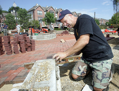 H. Rick Bamman -hbamman@shawmedia.com Former Algonquin firefighter Dan Killian of Algonquin levels limestone veneer for one of the wallsof the memorial at Algonquin's Riverfront Park. It will pay homage to those who died during the Sept. 11, 2001, attacks and two firefighters who died in the line of duty for the Algonquin-Lake in the Hills Fire Protection District. Money for the $30,000 memorial came from fundraisers held by the firefighters association.