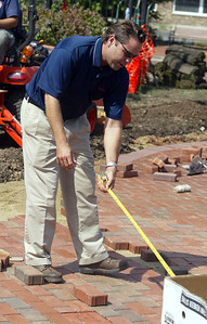 H. Rick Bamman -hbamman@shawmedia.com Nilco Landscaping's Brent Johnson mesures the brick walkway.