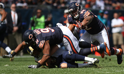 Mike Greene - mgreene@shawmedia.com Bears defensive tackle Amobi Okoye flattens St. Louis quarterback Sam Bradford as teammate Stephen Paea supports during the first quarter of a game Sunday, September 23, 2012 at Soldier Field in Chicago. Chicago (2-1) defeated St. Louis (1-2) 23-6.