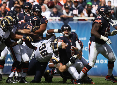 Mike Greene - mgreene@shawmedia.com Bears quarterback Jay Cutler releases the ball while being hit by St. Louis defensive end Chris Long during the first quarter of a game Sunday, September 23, 2012 at Soldier Field in Chicago. Chicago (2-1) defeated St. Louis (1-2) 23-6.