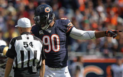 Mike Greene - mgreene@shawmedia.com Bears defensive end Julius Peppers complains to an official during the third quarter of a game against the St. Louis Rams Sunday, September 23, 2012 at Soldier Field in Chicago. Chicago (2-1) defeated St. Louis (1-2) 23-6.