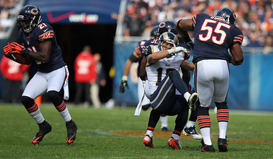 Mike Greene - mgreene@shawmedia.com Bears safety Major Wright (left) holds onto an interception as teammate Lance Brigges (right) knocks St. Louis wide receiver Danny Amendola off his feet during the fourth quarter of a game Sunday, September 23, 2012 at Soldier Field in Chicago. Chicago (2-1) defeated St. Louis (1-2) 23-6.