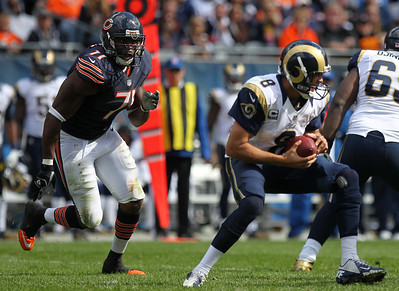 Mike Greene - mgreene@shawmedia.com Bears defensive lineman Israel Idonije closes in on St. Louis quarterback Sam Bradford during the third quarter of a game Sunday, September 23, 2012 at Soldier Field in Chicago. Chicago (2-1) defeated St. Louis (1-2) 23-6.