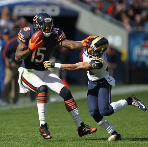 Mike Greene - mgreene@shawmedia.com Bears wide receiver Brandon Marshall pushes away from St. Louis cornerback Cortland Finnegan after a reception during the fourth quarter of a game Sunday, September 23, 2012 at Soldier Field in Chicago. Chicago (2-1) defeated St. Louis (1-2) 23-6.
