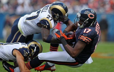 Mike Greene - mgreene@shawmedia.com Bears wide receiver Alshon Jeffery falls back after being hit by St. Louis safety Quintin Mikell and cornerback Cortland Finnegan during the fourth quarter of a game Sunday, September 23, 2012 at Soldier Field in Chicago. Chicago (2-1) defeated St. Louis (1-2) 23-6.