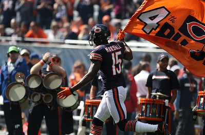 Mike Greene - mgreene@shawmedia.com Bears wide receiver Brandon Marshall carries a flag onto the field before the start of a game against the St. Louis Rams Sunday, September 23, 2012 at Soldier Field in Chicago. Chicago (2-1) defeated St. Louis (1-2) 23-6.