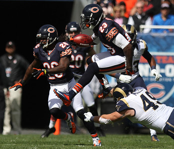 Mike Greene - mgreene@shawmedia.com Bears kick returner Devin Hester hurdles St. Louis' Brit Miller during a punt return in the first quarter of a game Sunday, September 23, 2012 at Soldier Field in Chicago. Chicago (2-1) defeated St. Louis (1-2) 23-6.