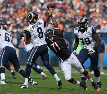 Mike Greene - mgreene@shawmedia.com Bears defensive lineman Israel Idonije breaks up a pass by St. Louis quarterback Sam Bradford during the fourth quarter of a game Sunday, September 23, 2012 at Soldier Field in Chicago. Chicago (2-1) defeated St. Louis (1-2) 23-6.