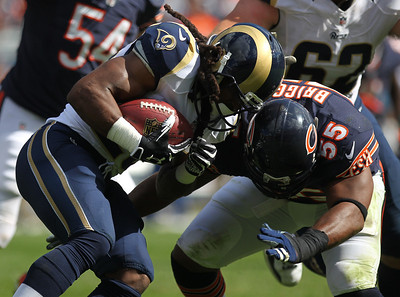 Mike Greene - mgreene@shawmedia.com St. Louis running back Daryl Richardson is hit by Bears linebacker Lance Briggs during a rush in the third quarter of a game Sunday, September 23, 2012 at Soldier Field in Chicago. Chicago (2-1) defeated St. Louis (1-2) 23-6.