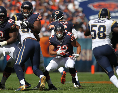Mike Greene - mgreene@shawmedia.com Bears running back Kahlil Bell breaks into a gap while rushing during the first quarter of a game against the St. Louis Rams Sunday, September 23, 2012 at Soldier Field in Chicago. Chicago (2-1) defeated St. Louis (1-2) 23-6.