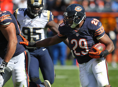 Mike Greene - mgreene@shawmedia.com Bears running back Michael Bush pushes teammate Roberto Garza while rushing during the third quarter of a game against the St. Louis Rams Sunday, September 23, 2012 at Soldier Field in Chicago. Chicago (2-1) defeated St. Louis (1-2) 23-6.
